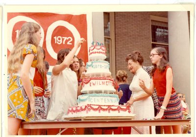 Mrs. Armon Lund and children with Centennial cake
