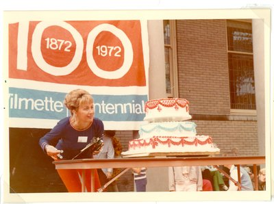 Woman with Centennial cake