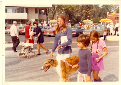 Woman and children walking a dog