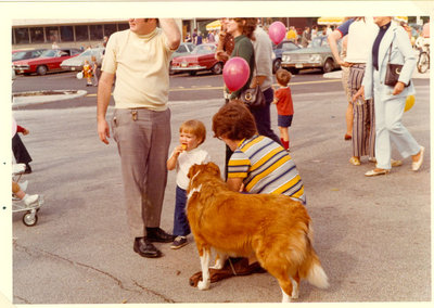 Parents and child with dog