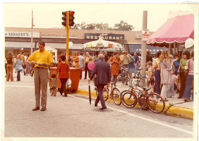 Street scene showing Lyman Sargent's drug store and Bob's Restaurant