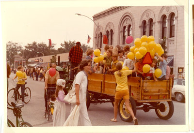 "Boy Scout ""float"" wooden wagon filled with children and yellow balloons"