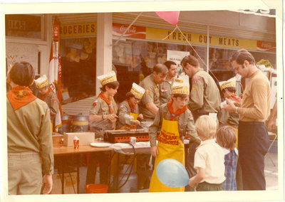 Boy Scouts making and selling pancakes on the street
