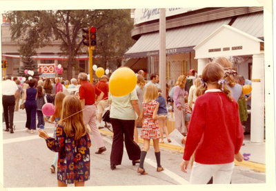 Street scene showing business next to Lyman Sergeants drugstore with marquee Wilmette Home Owners