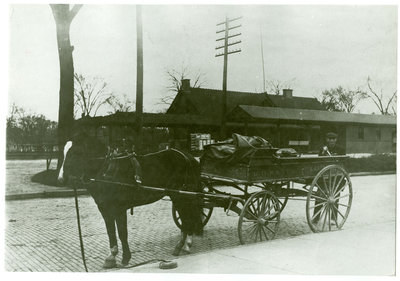 Horse and wagon in front of the Chicago & Northwestern railroad depot