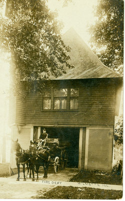 Wilmette Fire Station with horse-drawn fire truck wagon emerging from the building