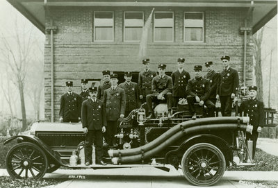 Wilmette firemen and a new chain-drive fire truck