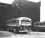 T.T.C., bus #1754, at Sherbourne Garage, Sherbourne St., n.w. cor. Esplanade E.;             looking s.w., showing garage, formerly T.R.C. motor shops, in background.