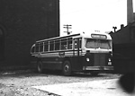 T.T.C., bus #1753, at Sherbourne Garage, Sherbourne St., n.w. cor. Esplanade E.;             looking s.w. to Frederick St., garage (formerly T.R.C. motor shops) in background.