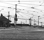 LAKESHORE RD., looking s.w. from King-Roncesvalles intersection to bridge over             C.N.R. tracks, showing Sunnyside Railway Station (C.N.R.) at left.