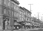 QUEEN ST. W., W. OF SIMCOE ST., n. side, looking e. from Brock Ave., showing             Standard Bank of Canada branch at left.