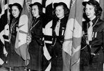 Girl Guides -- Girl Guide Colour Party at the Lady Baden-Powell Rally. L-R: Joy Johnson, Joyce Ellis, Sue Weber, Marion Stevenson