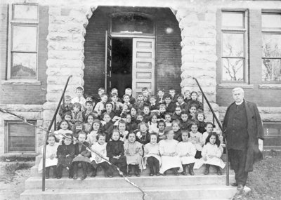 St. Bernard's Church Elementary School Students with Reverend Flannery
