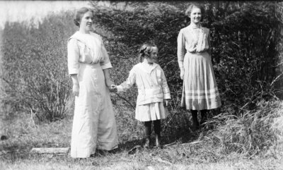 Middle Island:  Esther Hartlep (center) holding hands with her mother, Lillian, and unidentified teenage girl.