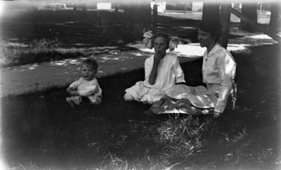 Hartlep Family Sitting in Grassy Shade in Summer