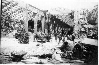 090 Army crew surveying damaged structure