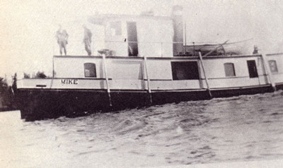 Two Men on the Steamboat Mike, circa 1926.