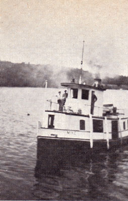 Three Men on the Steamboat Mike, circa 1919.