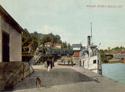 Postcard of Train Coming into Burk's Falls with The Wanita at the Dock, circa 1920