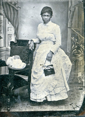 Tintype of Unidentified African American Woman Leaning on Chair [n.d.]