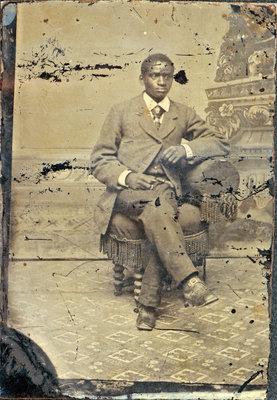 Tintype of African American Gentleman Seated on Stool [n.d.]