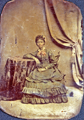 Tintype of Young African American Woman Seated at Table [n.d.]