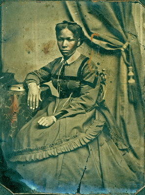 Small Tintype of Young Black Woman, Seated [n.d.]