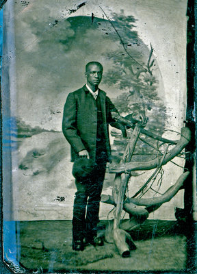 Tintype of African American Man Standing at Wooden Fence [n.d.]