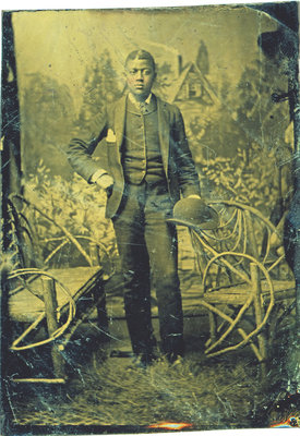 Tintype of African American Man Standing with Bowler Hat [n.d.]