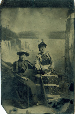 Tintype of Two African American Ladies with Niagara Falls Backdrop [n.d.]
