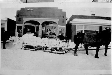 Horse-drawn sleds on Brant Street, carrying ice cut from the Bay, 1926