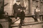 Mr. Weaver and boy at Edgington Station