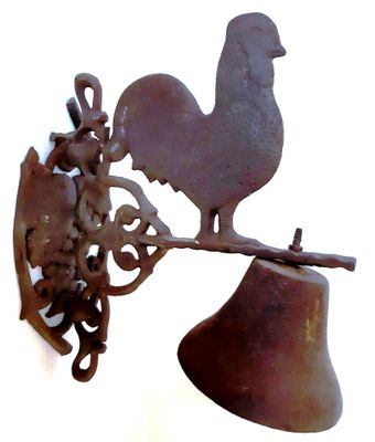 Bell with chicken motif