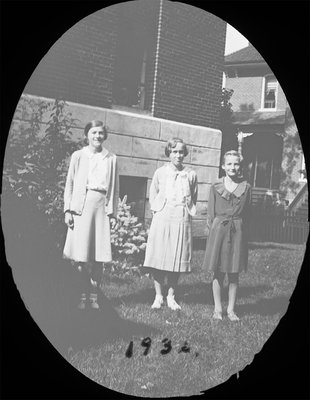 Portrait of three young women including Rosamond Hubble in front of Colborne High School