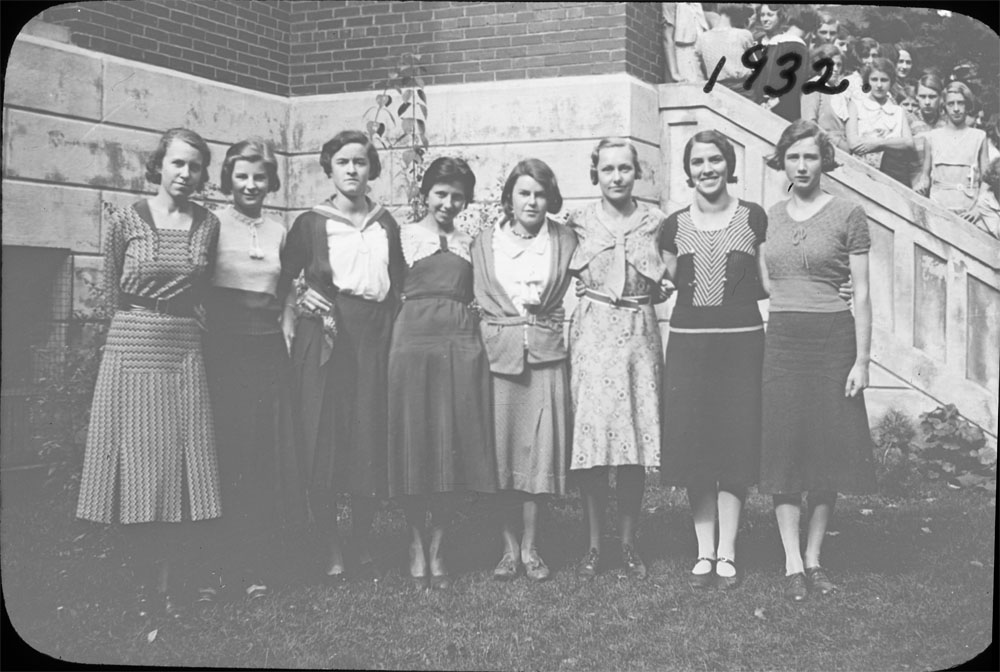 Portrait of a group of young women in front of Colborne High School; third from the left: Mabel Peacock; fourth from the right: Gertrude Bellamy; third from the right: Jessie Mutton