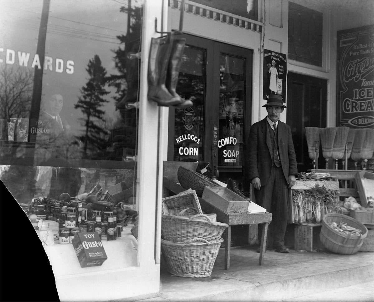 Charles Brown? in front of W.H. Edwards grocery store, Victoria Square, Colborne
