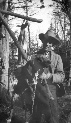 A deer hunter with his dog