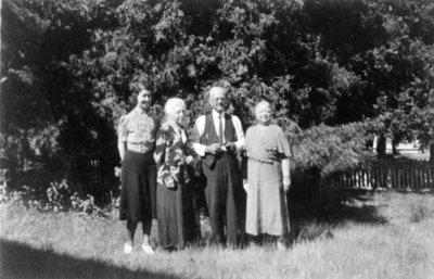 Reproduction photograph of Hattie E. (nee Black) Kerr, Lily Flindall, Robert Kerr, and Bea Flindall, Oak Hill Lake
