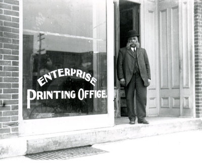 Henry Gale standing outside the Enterprise Printing Office