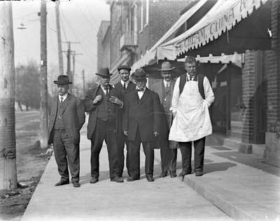 Vincent Cornwell and five unidentifed men standing in front of a grocery store