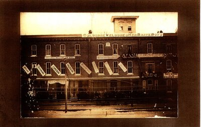 Photograph of Brunswick Hotel with South African War / Second Boer War banners, Cramahe Township, ca. 1902