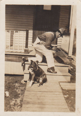A man with his dog on a porch