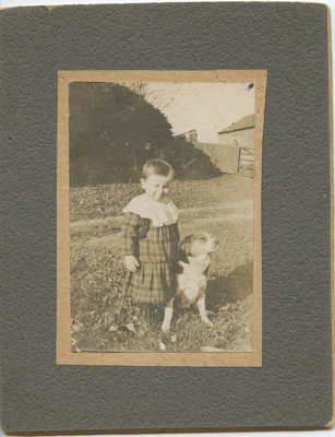 Unidentified boy with his dog