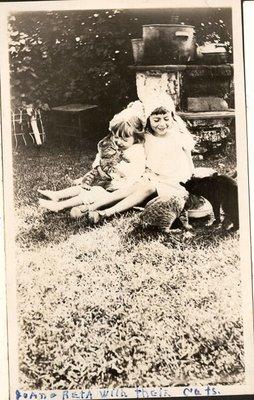Joan and Reta Turpin with their cats, Turpin Family Photograph Album