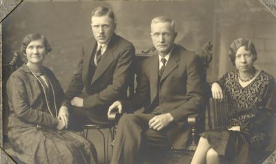 Studio portrait of Lena, Harold, John and Gertrude Coffee, Cramahe Township