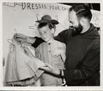 Father Francis at Holy Cross Festival Clothing Booth, 1962