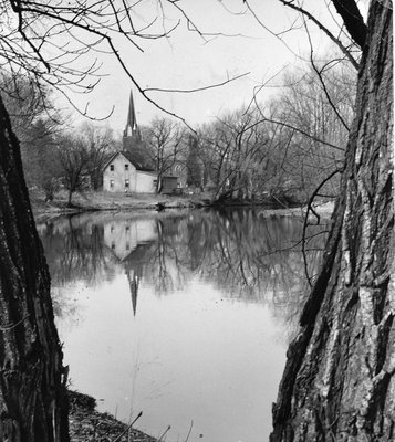 The Presbyterian Church steeple reflected in the mill pond