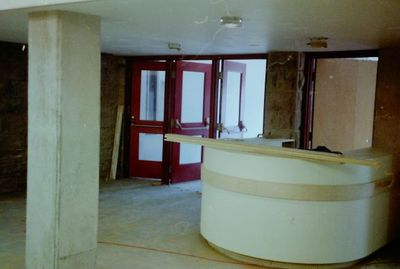 Halton Hills Cultural Centre - interior steel doors and welcome desk under construction.