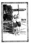 Two girls pose for a photo on the boardwalk at Stanley Park. 1938