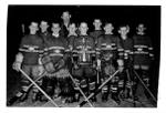 """Little NHL hockey team """"Montreal Canadiens"""" pose with their  trophy and their coach at Memorial Arena."""
